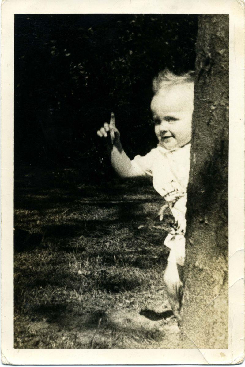 Doris behind tree