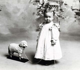 Todler girl with lamb