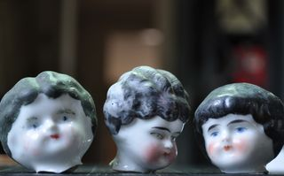 Three graces dolls heads